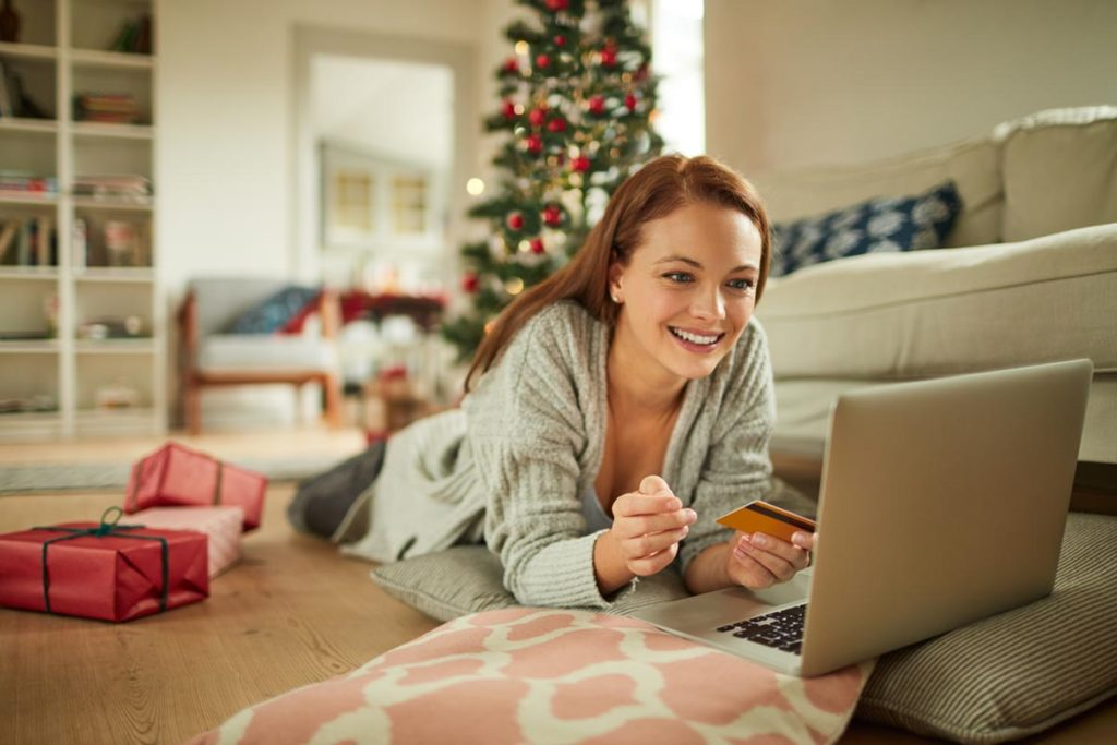 Photo of a young woman online shopping during the holidays.