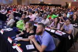 Primerica reps in audience engaged in speaker