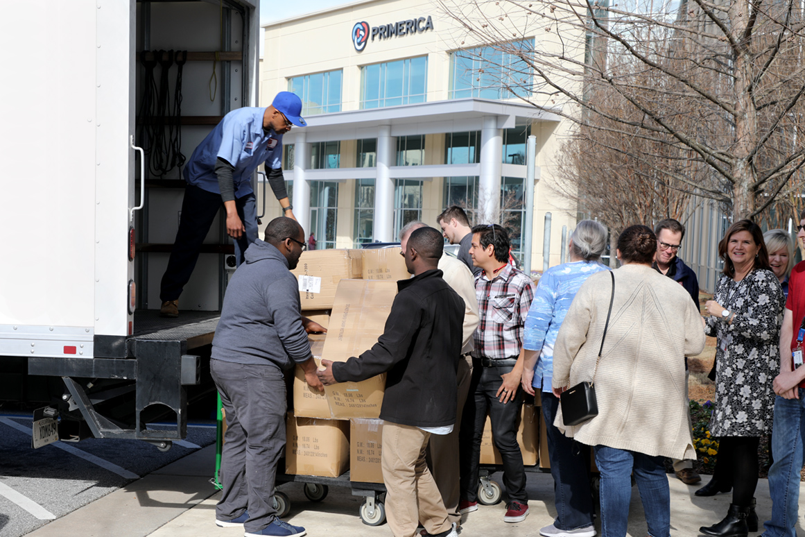 Photo of employees loading a Salvation Army truck