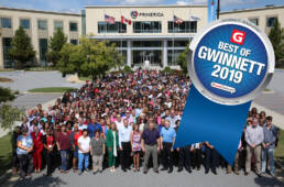 Photo of hundreds of employees outside of Primerica home office
