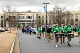 Photo of a parade in front of Primerica home office